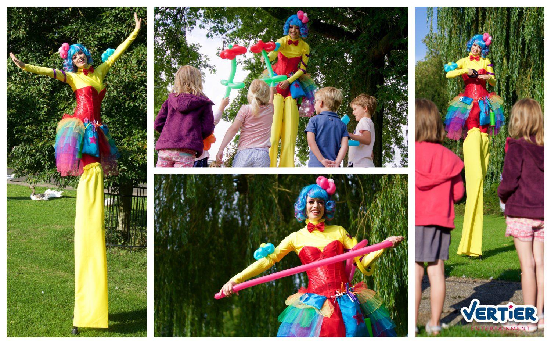 vrolijkste act op stelten, kleurrijke ballonnen dames die ballonvouwen